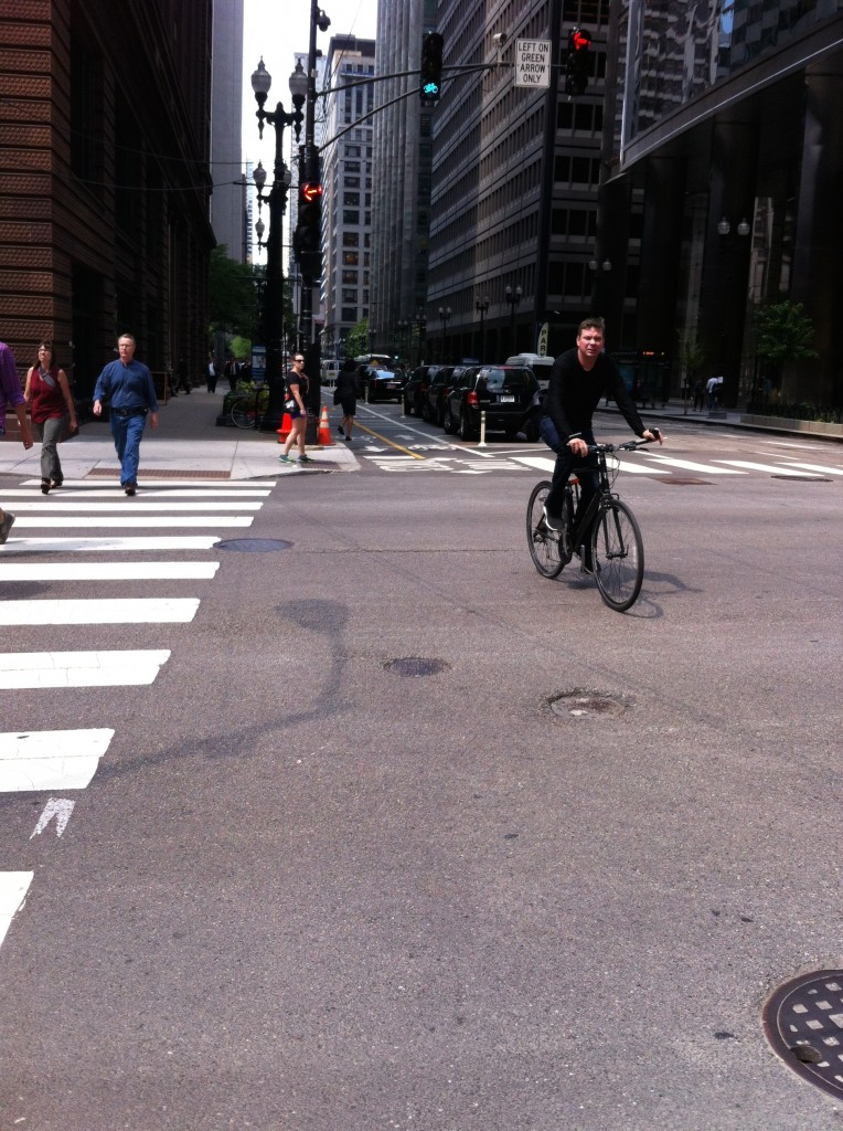 Protected bike lanes provide more safety for Chicago bikers, like the one on Dearborn Street, but most streets do not offer them.
